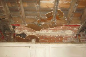 dry rot - image of dry rot on the ceiling of a period room