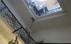 cantilevered stone staircase with iron balustrade
