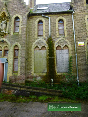 damp surveys - damp outside of an old church building