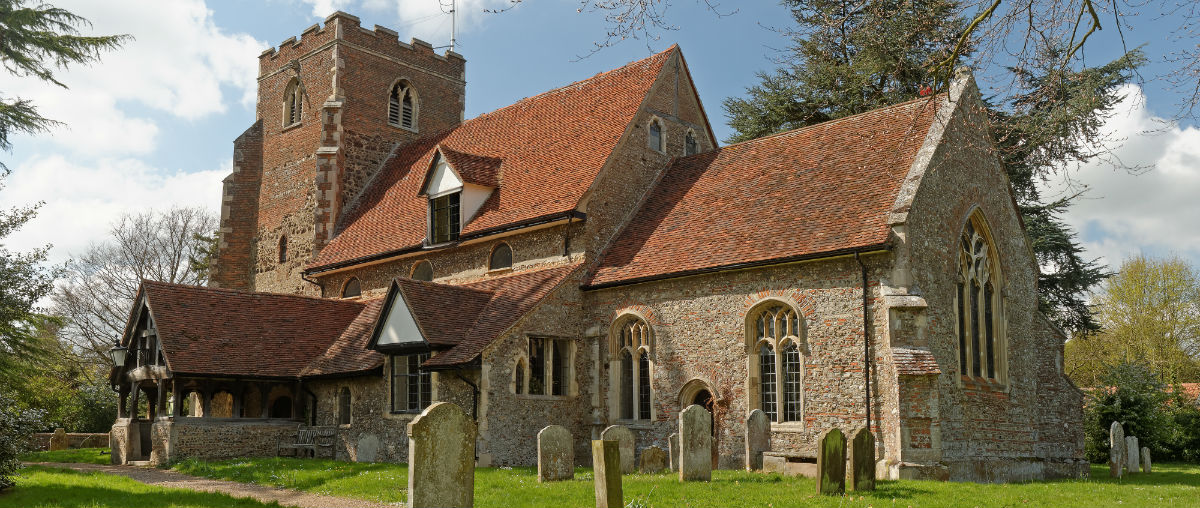 Old English Village Church with graveyard and square tower