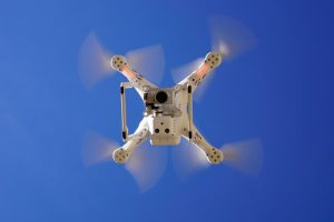 image of a drone in a blue sky